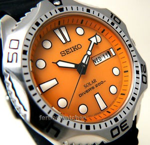 Seiko SNE109 orange quartz noir